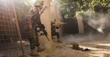 Pictured: Afghan commandos fight off an attack from Taliban forces.   In a maze of residential compounds 10 miles west of the Helmand capital Lashkar Gah, A unit of Afghan National Army (ANA) soldiers were holding a frontline against Taliban forces that, in the week or two prior, had pushed several miles closer toward the capital from their previous positions. As well as the ANA soldiers, Special Forces Commander Rohid (25) had 14 men and 30 Commandos bolstering the regular army. The SF and commandos had been there for one week and said they were being attacked up to three times per day by a force estimated to be around 100 strong. During an attack witnessed by Foreign Policy, many of the ANA soldiers abandoned their lookout positions and afraid, sheltered inside the compound buildings until the SF and commandos moved in and fought off the attack. One ANA soldier was wounded by a bullet that grazed his neck, while the Afghan forces claimed to have killed three Taliban during the shootout.